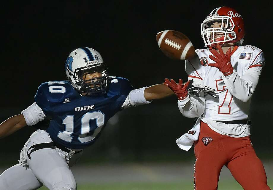 Middletown's Sowatey Lomotey is unsuccessful at breaking up a pass to New Canaan wide receiver Justin Greco who runs in for a touchdown in the Class L quarterfinals, Tuesday, Nov. 28, 2017, at Rosek-Skubel Stadium at Middletown High School. New Canaan won, 24-9. Photo: Catherine Avalone, Hearst Connecticut Media