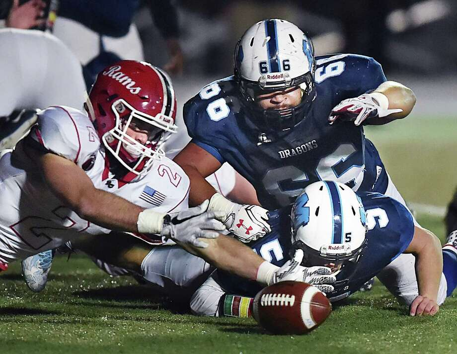 New Canaan linebacker Charlie Hane picks up a fumble by Middletown quarterback Stone Belzo (#5) in the Class L quarterfinals, Tuesday, Nov. 28, 2017, at Rosek-Skubel Stadium at Middletown High School. New Canaan won, 24-9. Photo: Catherine Avalone / Hearst Connecticut Media / New Haven Register