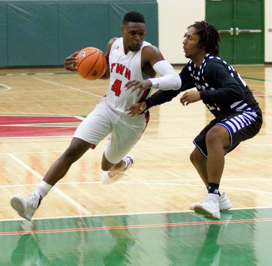 The Woodlands guard Romeo Wilbert (4) drives the ball against Willis guard Jamarcus Fisher (24) during the second quarter of a high school boys basketball game at The Woodlands High School, Tuesday, Nov. 28, 2017, in The Woodlands. Photo: Jason Fochtman, Staff Photographer / © 2017 Houston Chronicle