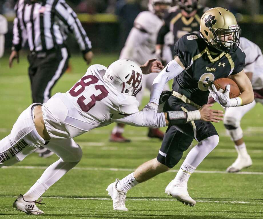 (John Vanacore/for Hearst Connecticut Media)  The Hand tigers played host to North Haven Indians in the opening round of the 2017 CIAC Class L football playoffs Tuesday, Novemeber 28, 2017 at the Surf Club in Madison. The Tigers moved on to the semi-finals by defeating the Indians 35-13. Photo: John Vanacore/For Hearst Connect