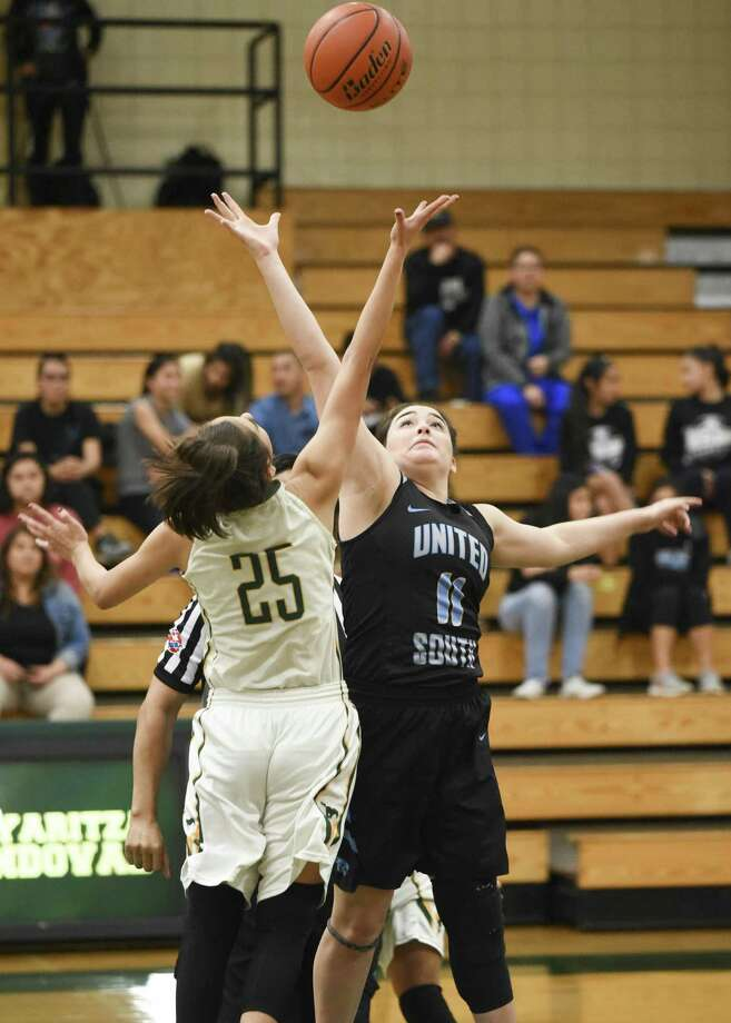 United South's Carolina Berlanga had eight points in a 55-36 win over Nixon Tuesday. The Lady Mustangs' Jennifer Pena scored 13 and left in the fourth quarter with an injury after a collision. Photo: Danny Zaragoza /Laredo Morning Times