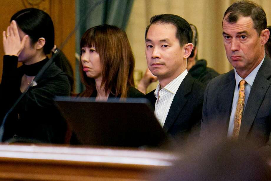 From center left: Tina Lam and Michael Cheng during a Board of Supervisors meeting at City Hall on Tuesday, Nov. 28, 2017, in San Francisco, Calif. The couple bought the streets and sidewalks of the Presidio Terrace. Wealthy residents there have sued the city and the couple to block them from selling the street to anyone else. Photo: Santiago Mejia, The Chronicle