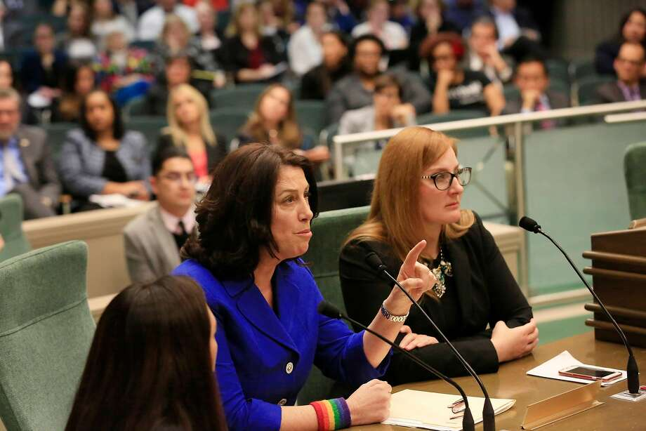 "Christine Pelosi (center), state Democratic Party Women's Caucus chair, tells the panel: ""We have molesters among us."" Photo: Lea Suzuki, The Chronicle"