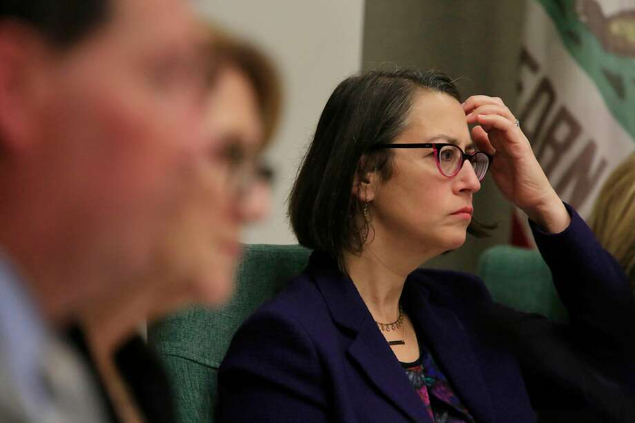 Laura Friedman (right), chair, Assembly Rules Subcommittee on Harassment, Discrimination, and Retaliation Prevention and Response, listens with others to speakers during the state Assembly's first public hearings in the Capitol  to examine complaints that the Legislature has fostered a culture of pervasive sexual harassment and abuse on Tuesday, November 28, 2017 in Sacramento, Calif. Photo: Lea Suzuki, The Chronicle
