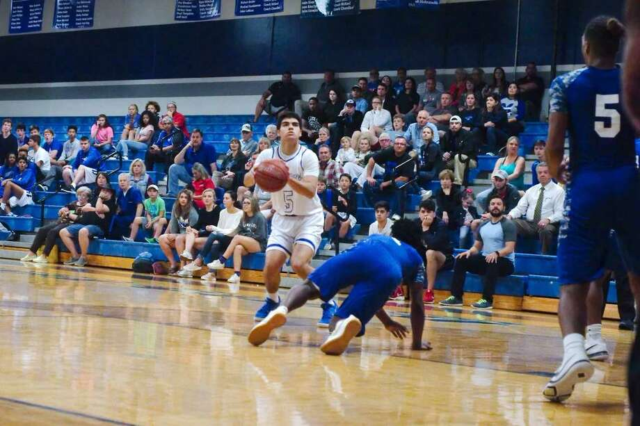 Alex Dehoyos scored 42 points, connecting on seven 3-pointers and hitting all 11 of his free throws in Friendswood's 75-64 win over Baytown Sterling Tuesday night at Friendswood High School. Photo: Kirk Sides
