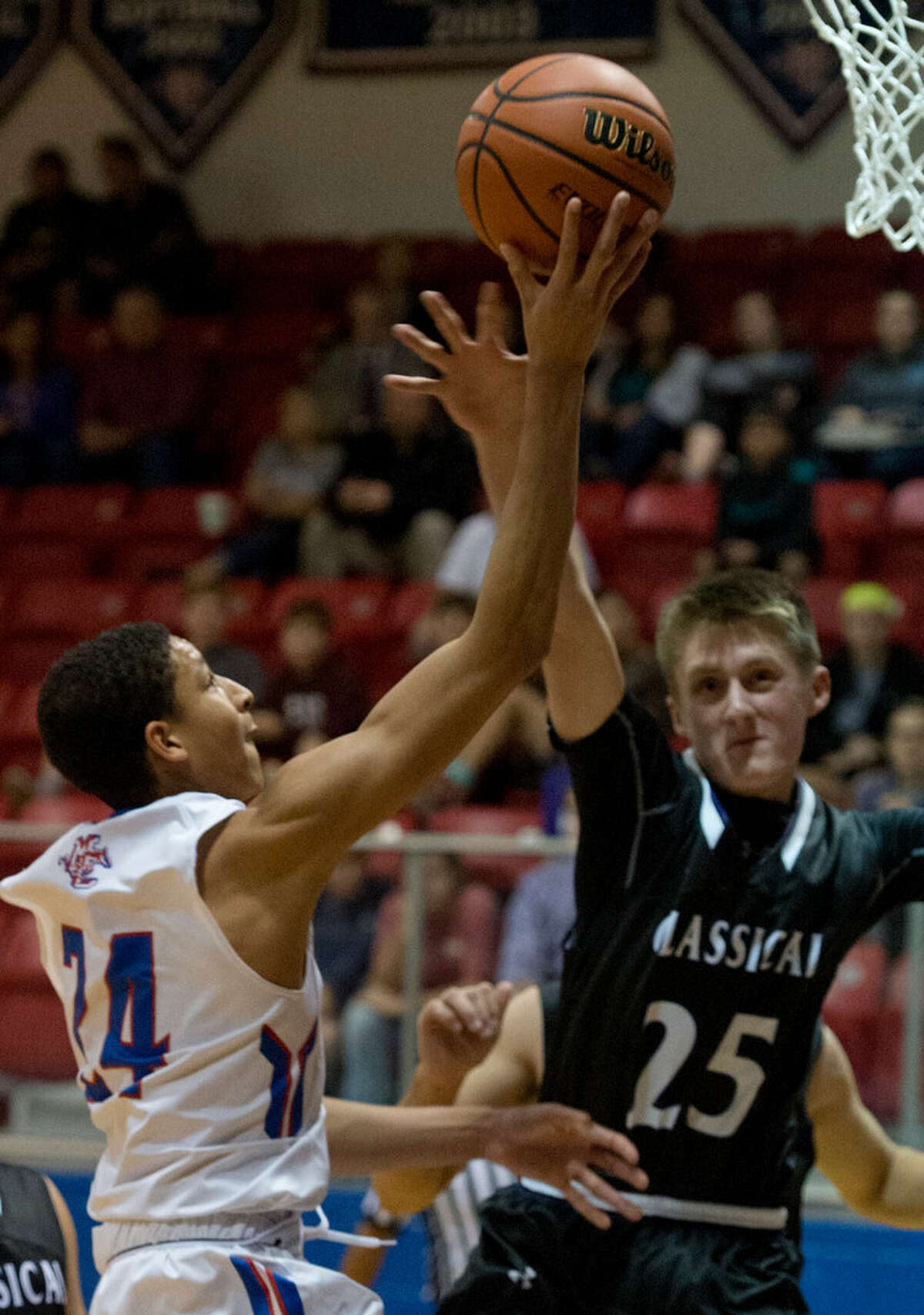 Midland Christian's Joseph Venzant drives to the basket as Midland Classical's Drew Littleton defends 11/07/17 at the McGraw Event Center. Tim Fischer/Reporter-Telegram