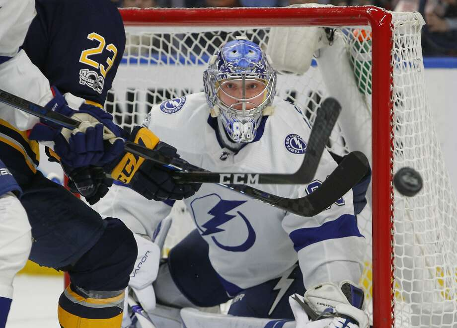 Lightning goalie Andrei Vasilevskiy keeps his eyes on the puck during the first period Tuesday night in Buffalo. Photo: Jeffrey T. Barnes, Associated Press
