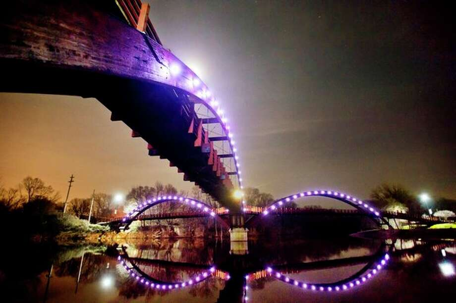 FILE: Brand new LED lights illuminate the Tridge on Monday. The lights have the ability to change color for special occasions and holidays. (Katy Kildee/kkildee@mdn.net)