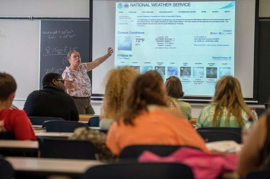 Laurie Reed, lecturer of physics at Saginaw Valley State University, teaches a meterology class at SVSU. Reed has been named a American Association of Physics Teachers Fellow for 2018. (Photo provided/Tim Inman, SVSU)