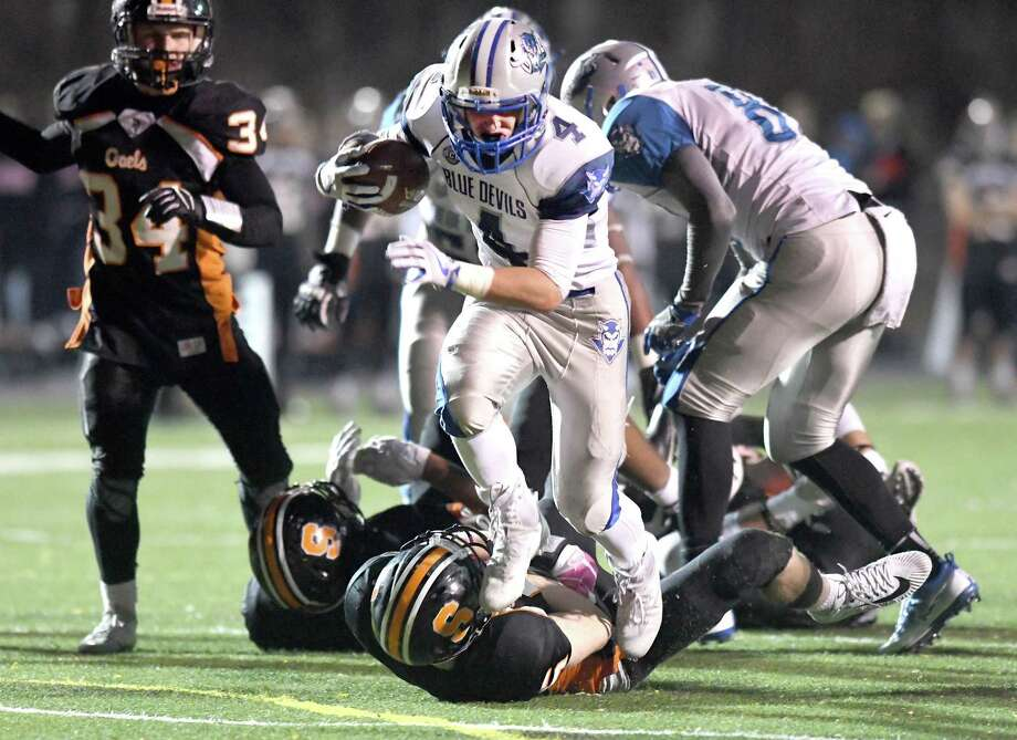 Game action from the West Haven at Shelton Class LL state football quarterfinals, November 28, 2017. Photo: Krista Benson / The News-Times Freelance