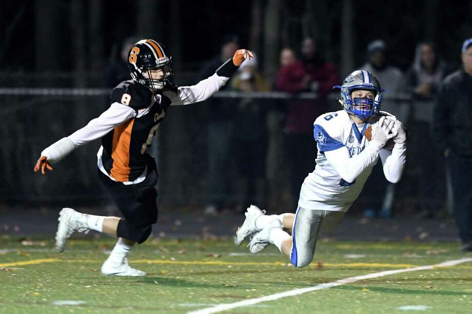 West Haven's Jordan Wetmore makes a reception in front of Shelton's David Yakowicz to set up the touchdown on the next play during the West Haven and Shelton Class LL state football quarterfinals at Shelton, November 28, 2017. Photo: Krista Benson / The News-Times Freelance