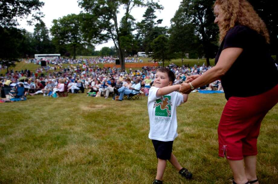 George Bentley, 4, treats his aunt Linda Mascendaro of Fairfield to a dance during the Brian Torff Soul Jazz Quartet performance before the 15th annual Greater Bridgeport Symphony pops concert at Fairfield University on Saturday, June 26, 2010. Photo: Lindsay Niegelberg / Connecticut Post