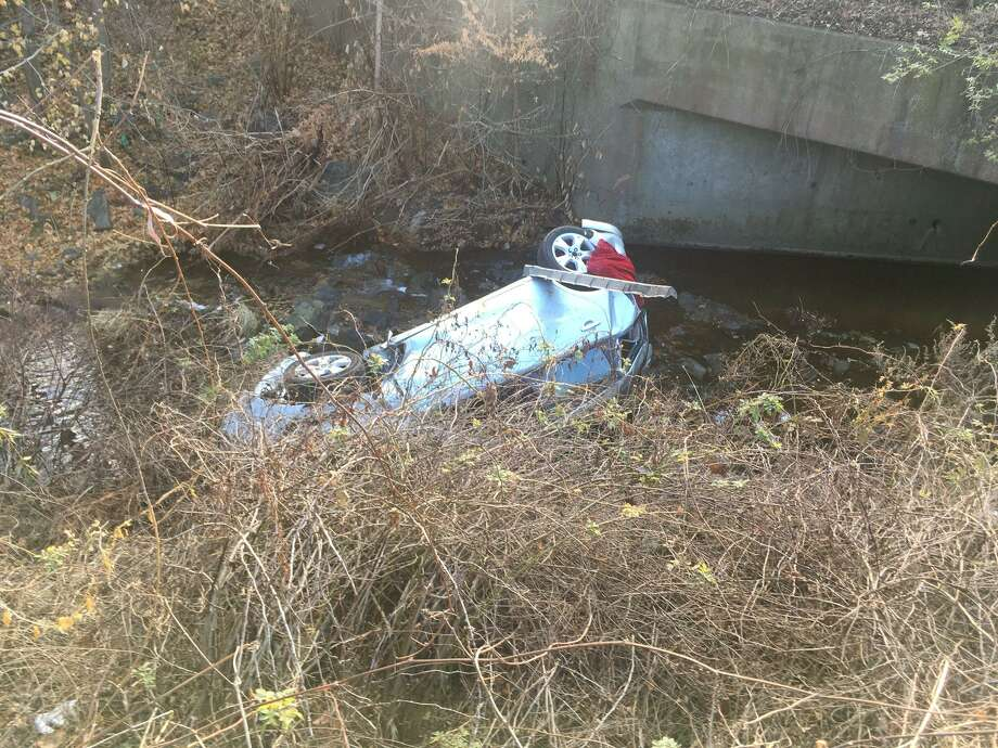 The left lane of Interstate 84 in Danbury was closed briefly Friday morning after a car rolled over into the median. No major injuries were reported Photo: / Contributed