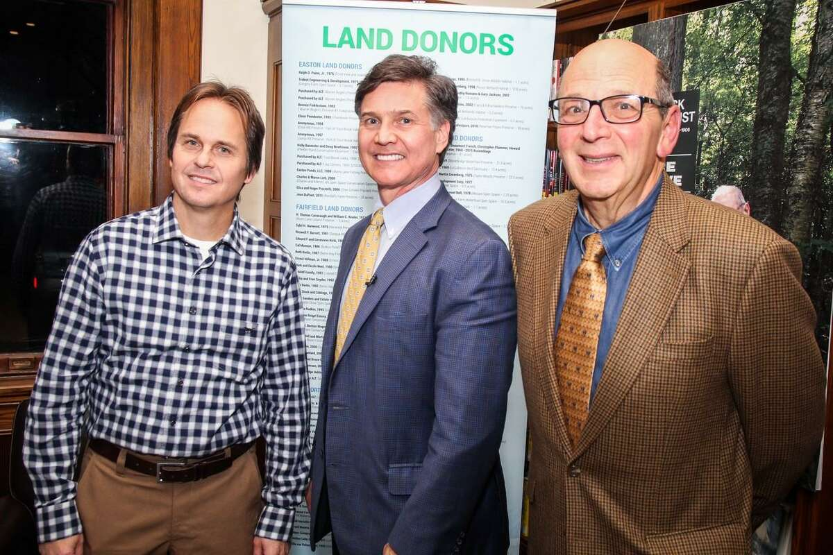 David Brant, executive director of Aspectuck Land Trust, (left) stands with Yale University Environmental Law and Policy Professor Dan Esty (center) and Don Hyman,(right) of Fairfield, newly elected president of the land trust.