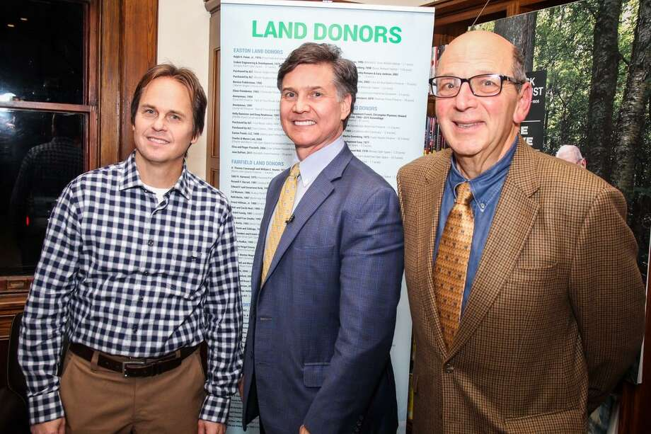 David Brant, executive director of Aspectuck Land Trust, (left) stands with Yale University Environmental Law and Policy Professor Dan Esty (center) and Don Hyman,(right) of Fairfield, newly elected president of the land trust. Photo: Contributed Photo