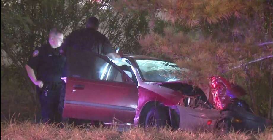 A car on Interstate 45 spun off the road and hit a tree early Wednesday when it was hit from behind by another vehicle that kept going.