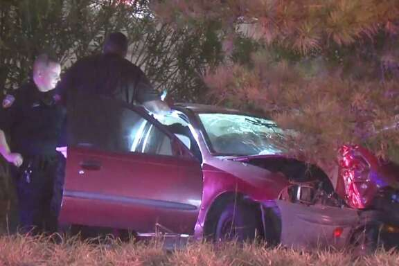 A car spun off the road and hit a tree early Wednesday when it was hit from behind by another vehicle that kept going.