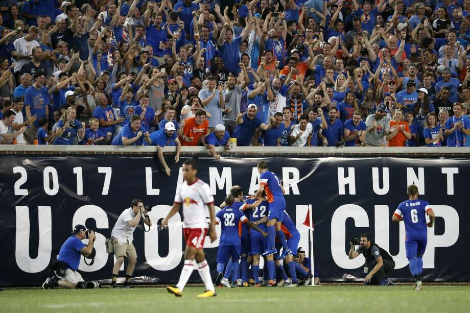 FC Cincinnati players celebrate after midfielder Corben Bone scores in the first half of a U.S. Open Cup soccer semi-final match against the New York Red Bulls, Tuesday, Aug. 15, 2017, in Cincinnati. (AP Photo/John Minchillo) Photo: John Minchillo/AP