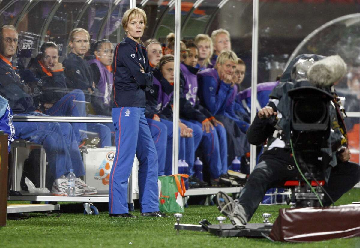 Former Netherlands' head coach Vera Pauw, standing, the Houston Dash's new coach, is seen during their quarter final Women's Euro 2009 soccer match against France in Tampere, Finland, Thursday evening, Sept. 3, 2009. The Women's European soccer championships take place in Finland from Aug. 23 to Sept. 10, 2009. (AP Photo/Matthias Schrader)
