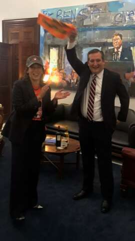 Texas U.S. Sen. Ted Cruz waves an Astros rally towel Tuesday as California U.S. Sen. Kamala Harris delivers California wine to settle their wager over the 2017 World Series, which the Los Angeles Dodgers lost to the Houston Astros (Kevin Diaz\Houston Chronicle).
