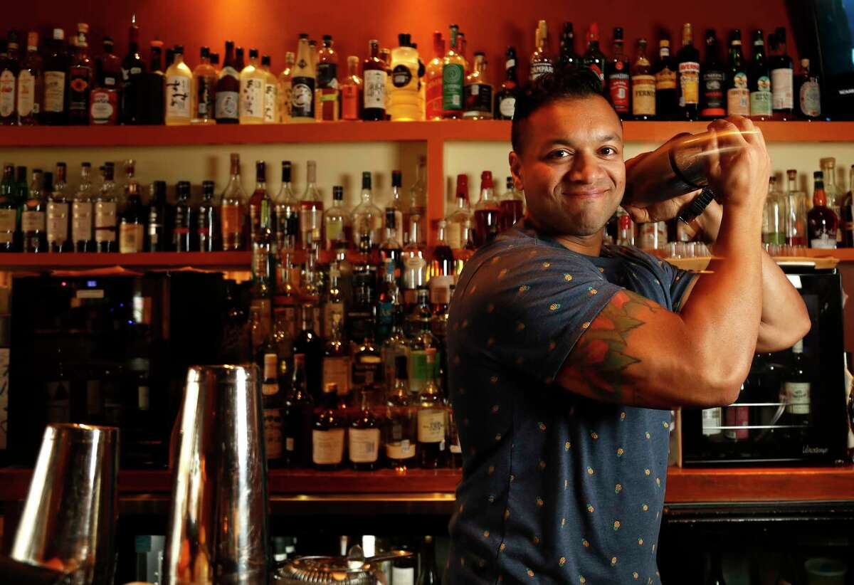 Bartender Mo Rahman makes drinks at Kata Robata, Tuesday, Nov. 21, 2017, in Houston. ( Karen Warren / Houston Chronicle )