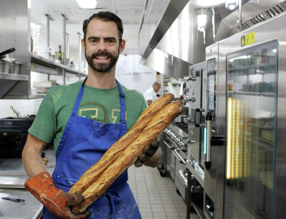 Rob VanKeuren of Wilton holds his signature sourdough baguettes inside the kitchen of the Tavern at GrayBarns in Norwalk on Tuesday, Nov. 28, 2017. Photo: Stephanie Kim / Hearst Connecticut Media