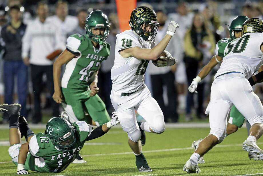 Tanner Faris slips by Eagle defenders in the second half as Canyon Lake plays Pleasanton in second round high school football playoffs on Nov. 24, 2017 Photo: Tom Reel /San Antonio Express-News / 2017 SAN ANTONIO EXPRESS-NEWS