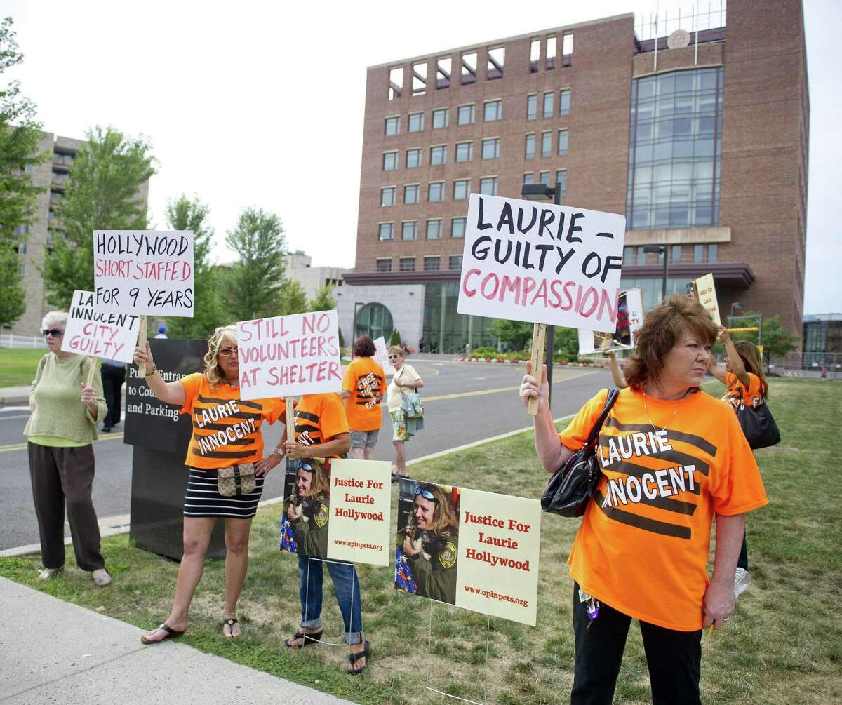 Supporters of former Stamford animal control manager Laurie Hollywood protest outside the courthouse after she was charged in 2014 with three counts of reckless endangerment.