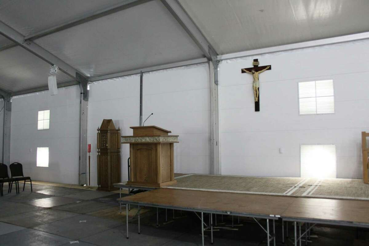 Inside the temporary church at St. Ignatius Loyola Catholic Church, a crew is putting the finishing touches and will seat a maximum of 1,001 people. Weekend services will begin on Dec. 2.
