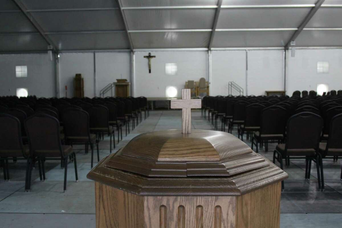 St. Ignatius Loyola Catholic Church put up a temporary church on its front lawn to host weekend services. After being flooded by Hurricane Harvey, all five buildings on its campus were damaged. The temporary church will attach air conditioning, heating and speakers to host services on the first weekend of December..