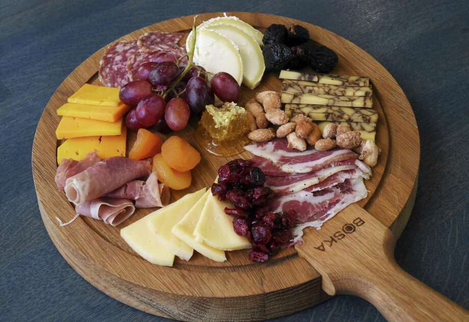The charcuterie at Cafe Dijon includes smoked gouda, port derby cheddar, mimolette and mi ti cunel cheeses, as well as sweet coppa, salami di parma and prosciutto, as well as dried figs, dried apricots, dried cranberries, candied almonds and a honeycomb. Photo: Billy Calzada /San Antonio Express-News / San Antonio Express-News