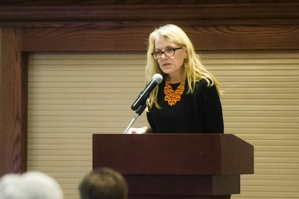 The Arc of Midland executive director Jan Lampman speaks during a fundraiser luncheon for the organization on Wednesday, Nov. 29, 2017 at the Great Hall Banquet & Convention Center. The Arc of Midland creates programs that help individuals with intellectual and developmental disabilities. (Katy Kildee/kkildee@mdn.net)