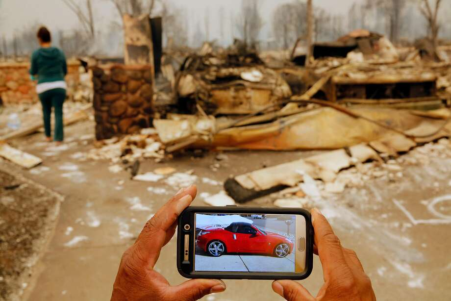 Keith Norris shows what his car destroyed in the fire looked like before the fire, in Santa Rosa, Ca., on Monday October 9, 2017. Massive wildfires ripped through Napa and Sonoma counties early Monday, destroying hundreds of homes and businesses on Monday October 9, 2017 Photo: Michael Macor, The Chronicle