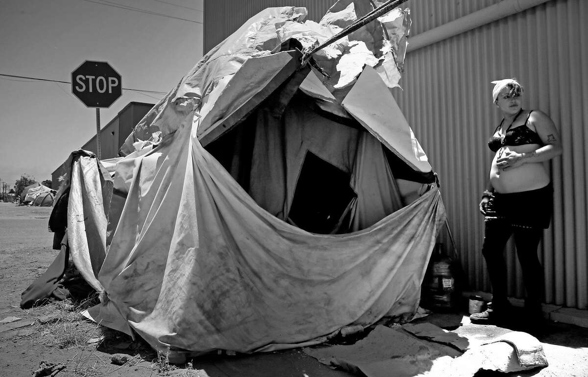 Samantha, 22 who is 8 months pregnant and been homeless for 5 years is living in an encampment on the corner of Cedar and 2nd streets in Berkeley, Ca., as seen on Friday June 23, 2017.