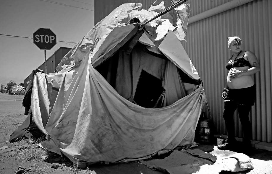 Samantha, 22 who is 8 months pregnant and been homeless for 5 years is living in an encampment on the corner of Cedar and 2nd streets in Berkeley, Ca., as seen on Friday June 23, 2017. Photo: Michael Macor, The Chronicle