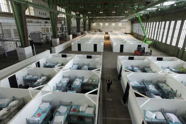 BERLIN, GERMANY - FEBRUARY 11:  In this aerial view cubicles furnished with bunk beds stand ready to accommodate refugees and asylum applicants in Hangar 6 of former Tempelhof Airport on February 11, 2016 in Berlin, Germany. Tempelhof, once an airport in the city center and first built in the 1930s, now houses approximately 2,600 refugees in three former hangars. Berlin city authorities recently approved plans to expand its capacity to house the newcomers with an additional 90 shelters with space for 30,000 people. An estimated 50,000-80,000 migrants and refugees already live in Berlin. Germany received 1.1 million refugees and migrants in 2015 and is expecting to continue to receive large numbers in 2016.  (Photo by Sean Gallup/Getty Images)