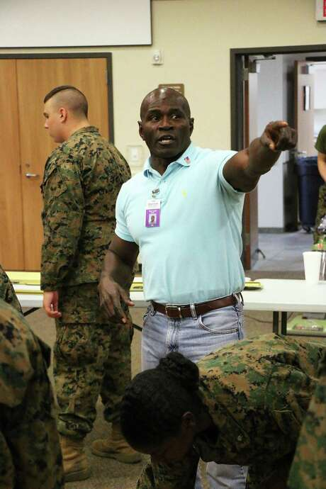 Sgt. Major Sam Lewis, USMC ret., gives directions to his students in the Dayton High School Marine Junior ROTC program as they set up for their annual military ball. Photo: David Taylor
