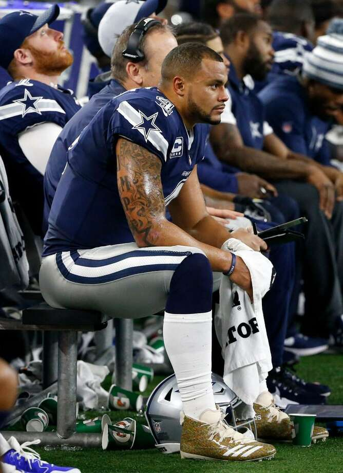Dallas Cowboys' Dak Prescott sits on the bench during a Nov. 23 loss to the Los Angeles Chargers in Arlington, Texas. Photo: Ron Jenkins /AP Photo