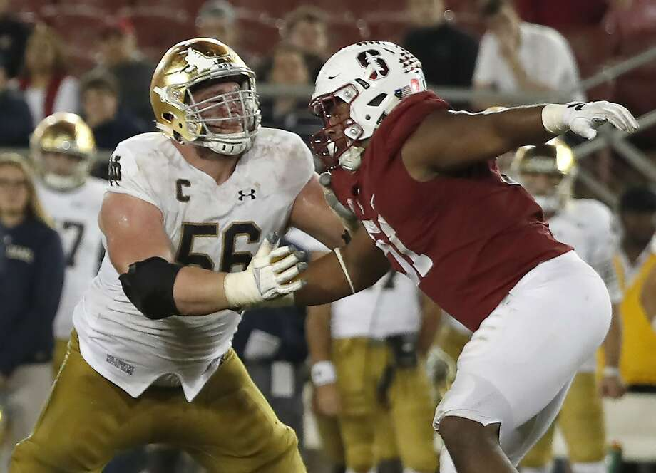 Jovan Swann (right) saw extensive play against Notre Dame, including offensive lineman Quenton Nelson, on Saturday. Photo: Tony Avelar, Associated Press