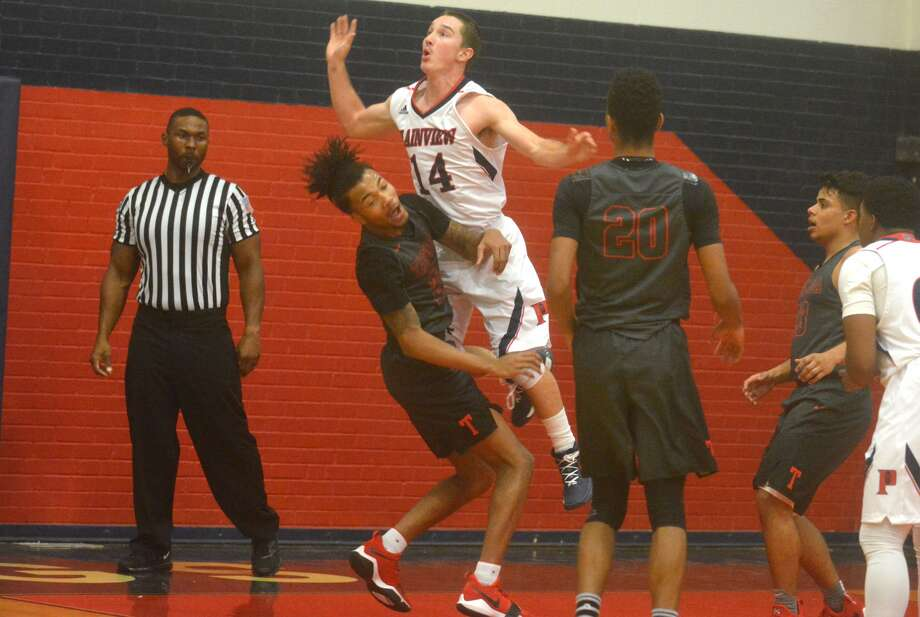 Plainview's Treyton Peterson, 14, collides with Tascosa's Cameron Brown as Peterson drives to the basket during a game at the Dog House Tuesday night. Photo: Skip Leon/Plainview Herald