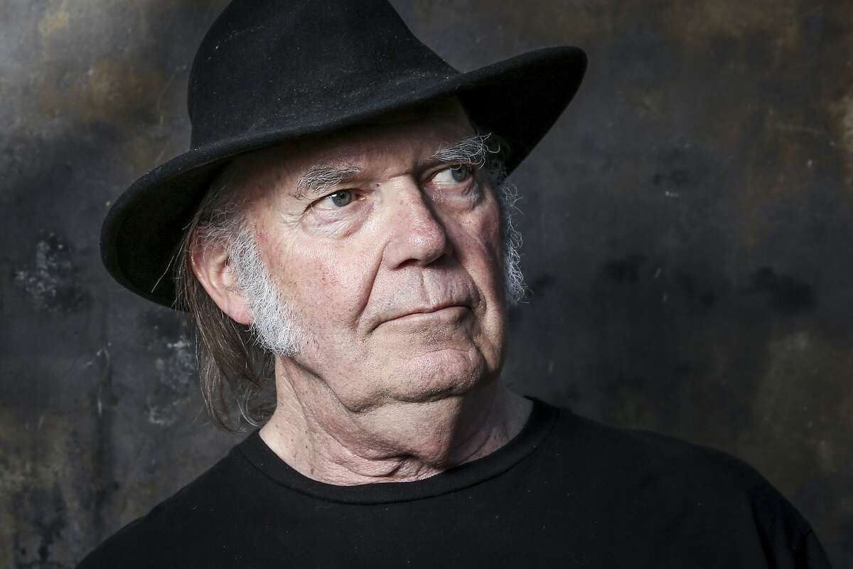 FILE - In this May 18, 2016, file photo, Neil Young poses for a portrait in Calabasas, Calif. Young announced on Nov. 11, 2017, he would open his vast archive of music for anyone to listen to online for free next month. (Photo by Rich Fury/Invision/AP, File)