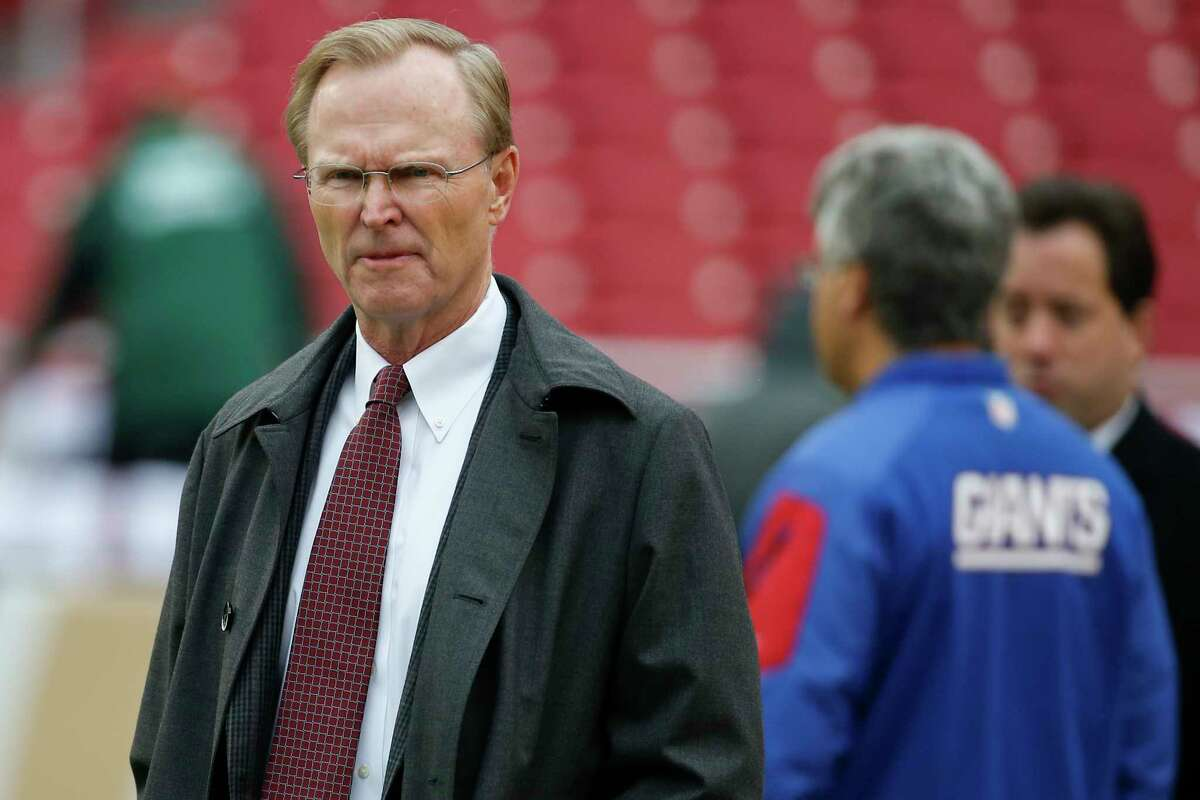 FILE - In this Sunday, Nov. 29, 2015 photo, New York Giants co-owner John Mara walks across the field before an NFL football game against the Washington Redskins in Landover, Md. A visibly shaken Giants owner John Mara said Wednesday, Aug. 24, 2016 he was fine with the NFL's suspension of placekicker Josh Brown for one game, despite allegations Brown abused his ex-wife as many as 20 times prior to the Giants signing Brown to a two-year extension last spring. (AP Photo/Alex Brandon, File)