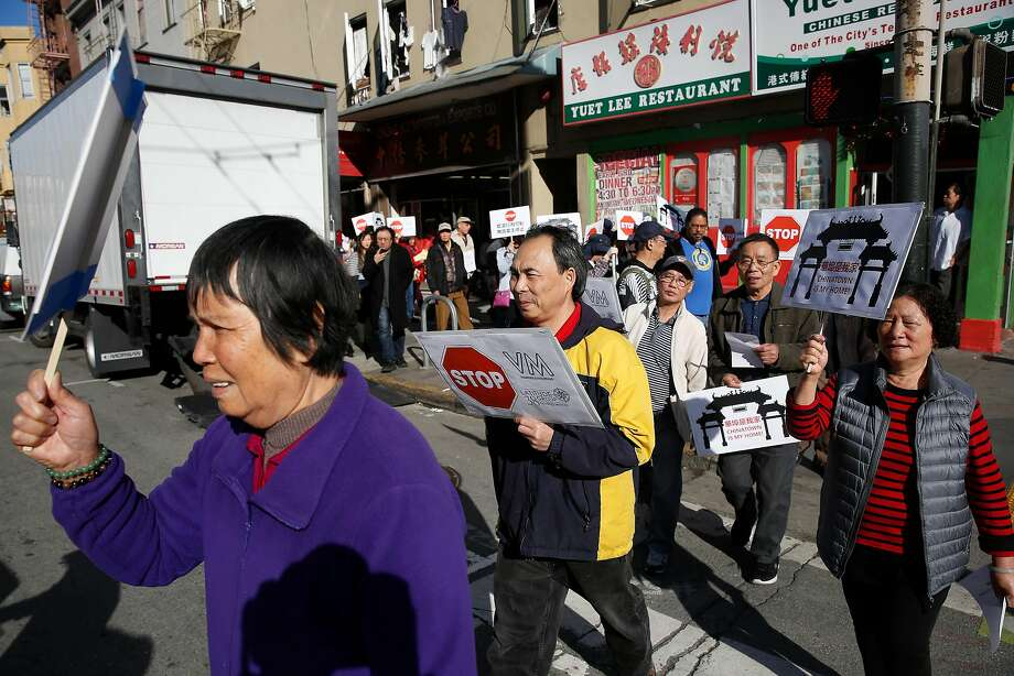 People rally along Stockton Street on Wednesday, November 29, 2017 in San Francisco, Calif. Today a coalition of tenant, civl rights, and community organizations announced a campaign to protect tenants against intimidation, evictions, and increasing rents in Chinatown. small photo; People listen to speakers at a rally on Wednesday, November 29, 2017 in San Francisco, Calif. Today a coalition of tenant, civl rights, and community organizations announced a campaign to protect tenants against intimidation, evictions, and increasing rents in Chinatown. Photo: Lea Suzuki, The Chronicle