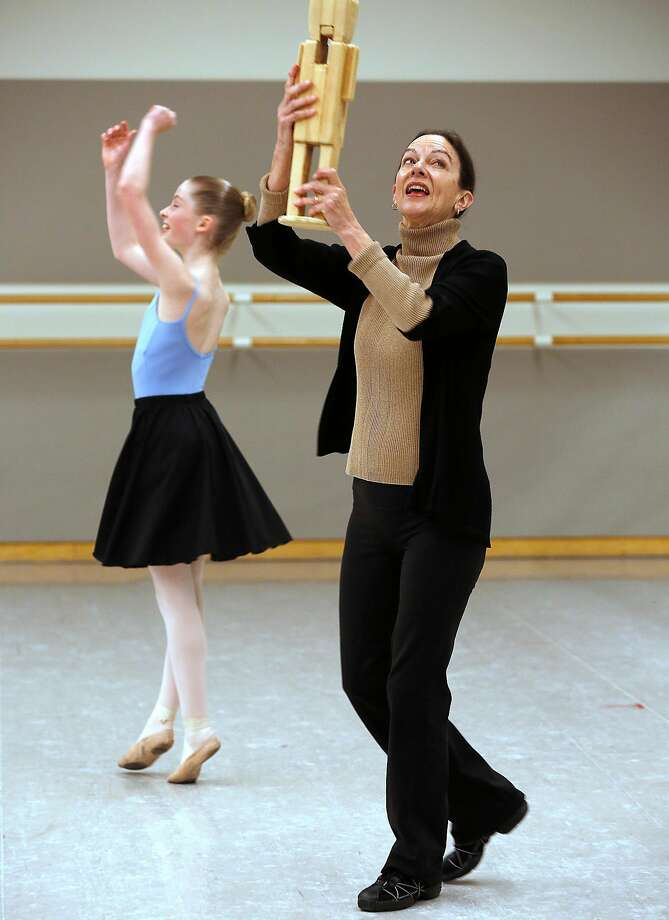 Anita Paciotti (right) rehearses with Olivia Callander (left), 15, one of the dancers rehearsing the role of Clara in the Nutcracker on Thursday, November 9, 2017, in San Francisco, Calif.  Anita Paciotti who has been everything from a prima ballerina to a ballet master is celebrating her 50th anniversary season with San Francisco Ballet. Photo: Liz Hafalia, The Chronicle