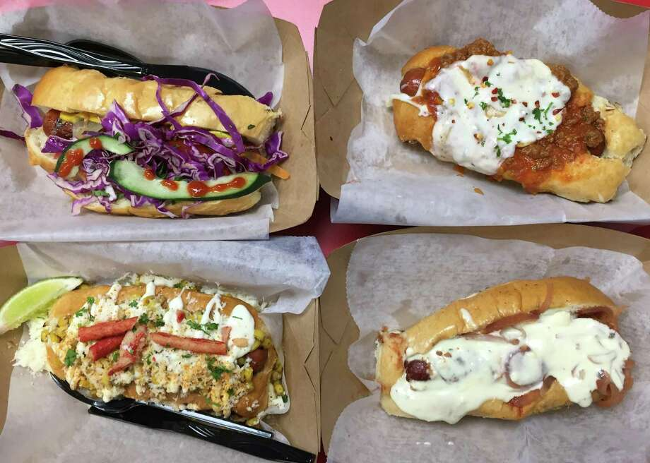 A quartet of hot dogs from The Dogfather. Photo: Paul Stephen / San Antonio Express-News