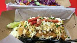 The Elote is topped with roasted corn, smoked queso, crumbled Takis and mayo.