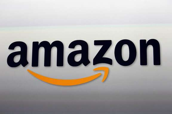 FILE - This Sept. 6, 2012, file photo shows the Amazon logo in Santa Monica, Calif. Ahead of Thanksgiving 2017, Amazon is giving Prime members their first taste of special discounts at its recently-acquired Whole Foods stores. (AP Photo/Reed Saxon, File)
