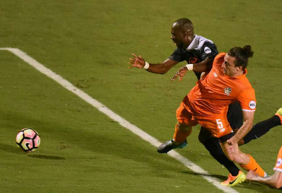 San Antonio FC midfielder Billy Forbes (back) is fouled by Jonathan Levin of Tulsa Roughnecks FC during second-half USL playoffs action at Toyota Field on Oct. 21, 2017. The foul led to a successful direct free kick. San Antonio FC won, 2-1. Photo: Billy Calzada /Express-News