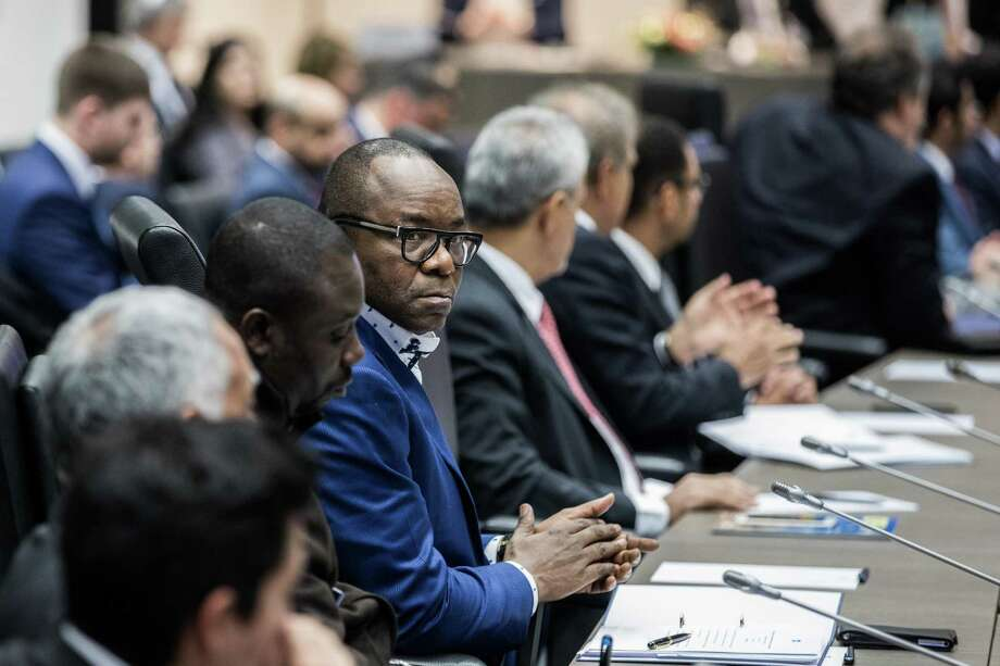Emmanuel Ibe Kachikwu, Nigeria's petroleum and resources minister, center, looks on during a news conference the 173rd Organization of Petroleum Exporting Countries (OPEC) meeting in Vienna, Austria, on Wednesday, Nov. 29, 2017. OPEC and Russia are said to have agreed they should extend oil-supply cuts deeper into next year, but Moscow wants clarity on an exit strategy before giving formal consent. Photo: Akos Stiller /Bloomberg / © 2017 Bloomberg Finance LP