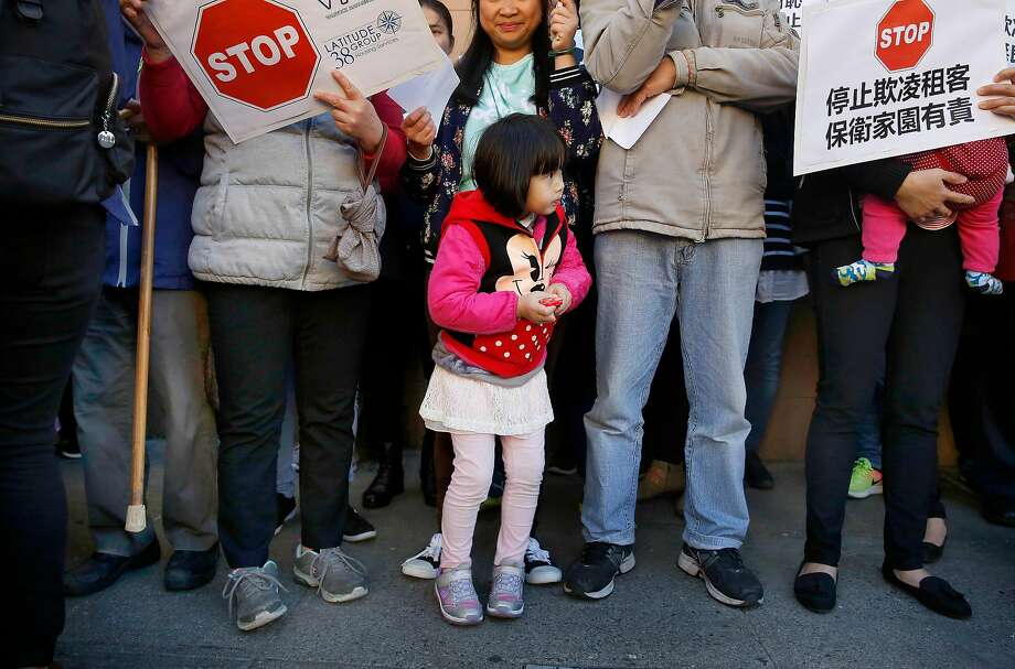 Shirley Chen, 4, stands with her mother as they attend a rally outside 1350 Stockton on Wednesday, November 29, 2017 in San Francisco, Calif.   Today a coalition of tenant, civl rights, and community organizations announced a campaign to protect tenants against intimidation, evictions, and increasing rents in Chinatown. Photo: Lea Suzuki, The Chronicle
